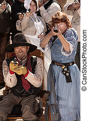Elderly Gunfighters in Old Town - Armed older man and woman...