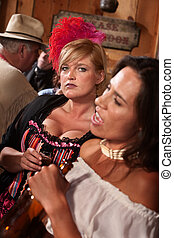 Pretty Women in Old West Saloon - Two beautiful women in an...