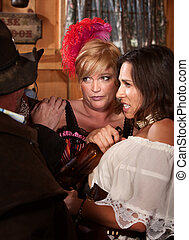 Disgusted Women in Saloon - Disgusted women react as cowboys...