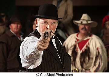 Old Western Smoking Man with Gun - 1800s style man in old...