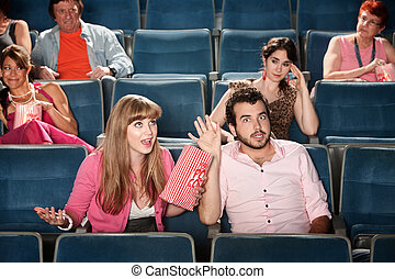 Couple Argue In a Theater - Annoyed audience and arguing...
