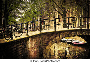 Amsterdam. Romantic bridge over canal. - Amsterdam, Holland,...