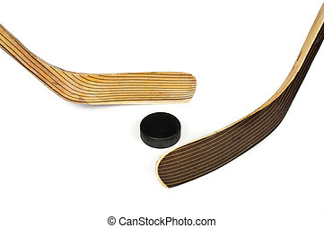 Hockey stick and puck. Isolated on white background