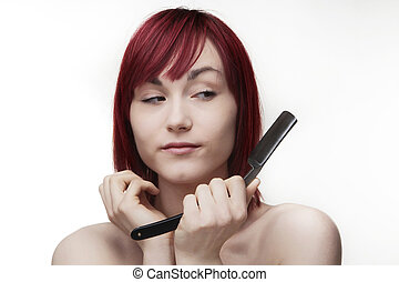 a bit cut up - woman holding a cut throat razor looking at...