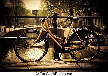 Amsterdam. Romantic canal bridge, bike