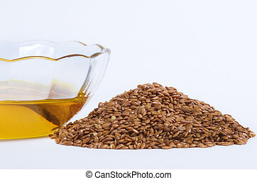 Flax Seed and Flaxseed oil - Flaxseed oil in bowl and whole...