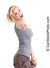 Yes, you! - Young cute smiling girl pointing on you isolated...
