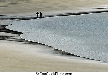 Secluded Beach  - Couple walks in a secluded beach.