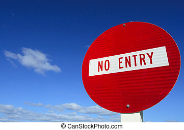 No Entry  - Do not enter - road sign under cloudy blue sky.