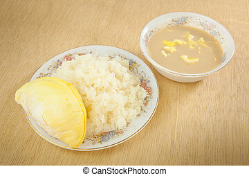 Durian sticky rice on the wood background