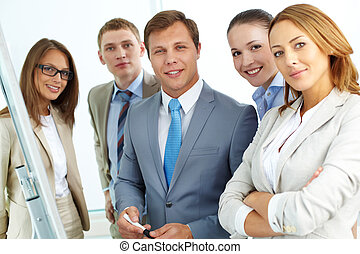 Business environment - Portrait of five businesspeople...