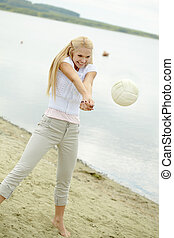 Beautiful volleyballer - Photo of joyful blond woman playing...