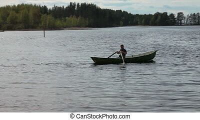 Rowing Boat Floats on the Lake