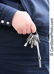 Keyring in the hand of a woman in uniform