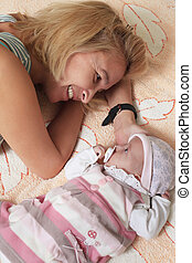 Mother with baby - Mother with her newborn baby in home