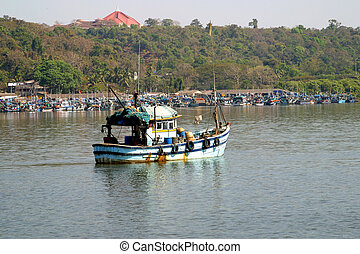Fisherman Boat Harbor Panaji - a fisherman boat in the...
