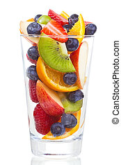 salad with fresh fruits and berries in glass on white...