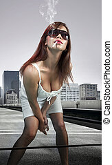 woman smoking cigarette - Beautiful woman on urban...
