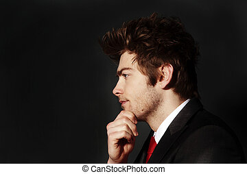 deep in thought - low key portrait image of business man who...