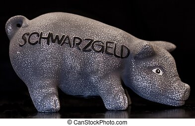 pig moneybox on black, dark room shot with flash light on...