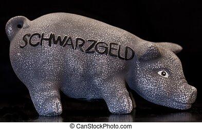 pig moneybox on black, dark room shot with flash light on...