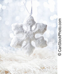 White Snow flake - Bright Snow flake on defocused white...
