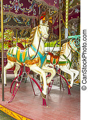 Two colourful horses in a vintage (old fashioned) carousel