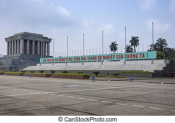 Ho Chi Minh mausoleum with long slogan banner. - Text says,...