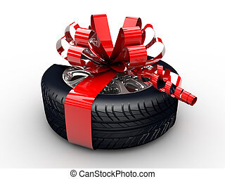 Tyre with ribbon - A tyre with a red ribbon like a present