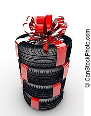 Tyres with ribbon - Four tyres with a red ribbon like a...