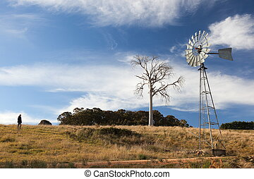 A rural landscape with windmill Near Oberon New South Wales...