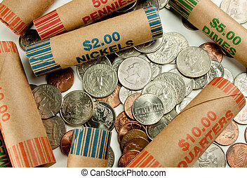 Coins And Wrappers - Coins laying with coin wrappers on...