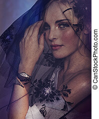woman under black veil - portrait of romantic beautiful...