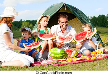 family picnic - happy family have a picnic outdoor