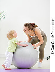 Mother and kid having fun in gym