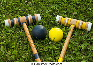 croquet equipment - two croquet mallets and balls on a...