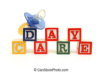 Day Care - An infants pacifier next to the words day care