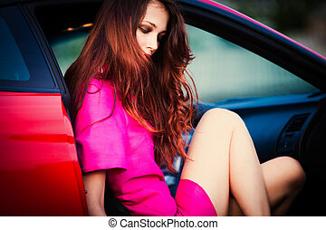 stylish woman in red car - sensual stylish woman in pink...