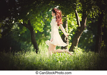redhead woman in the wood - redhead woman illuminated by...