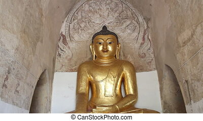 Gold Buddha inside pagoda in Bagan