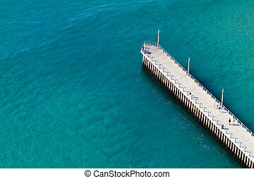 overhead view of ocean and pier