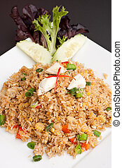 Crab Fried Rice - A Thai dish of crab fried rice presented...