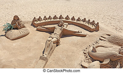 Jesus Christ Statue made of sand on the beach