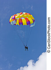 Duo parasailing against clear sky