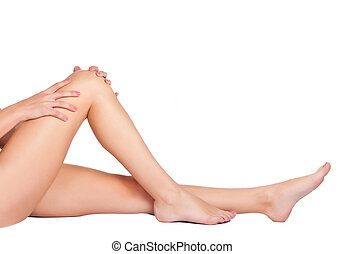 Female Legs - Womans legs isolated on a white background