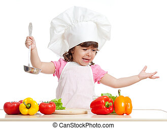 adorable kid girl preparing healthy food - funny girl...