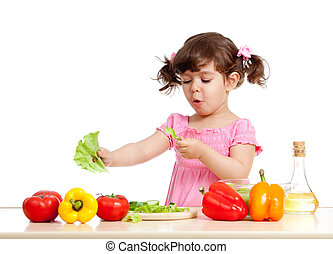 adorable kid girl preparing healthy food