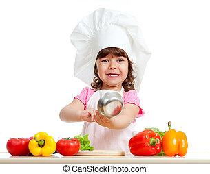 adorable kid girl preparing healthy food - funny girl...