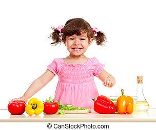 adorable kid girl preparing healthy food - happy kid girl...