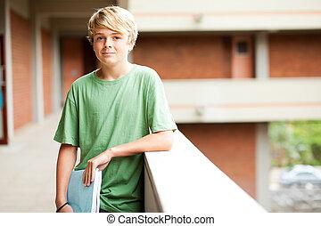 cute high school boy in school building